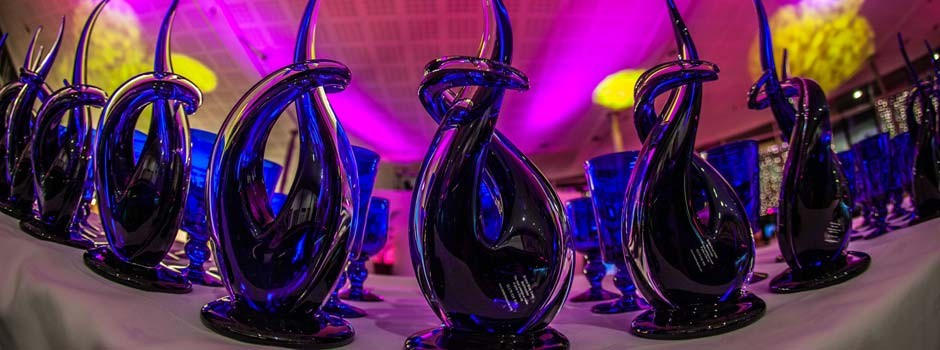 blue glass award trophies waiting to be presented