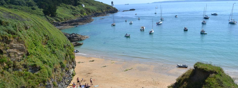 people and boats at Great Molunan beach on St Anthony's headland