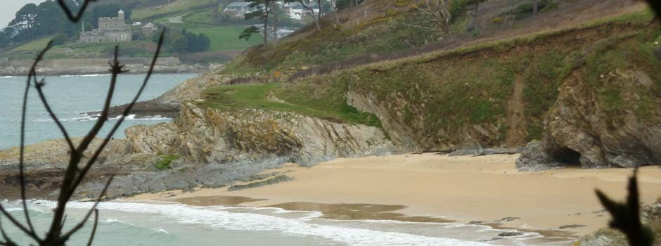a deserted Great Molunan beach at St Anthony's headland with St Mawes behind