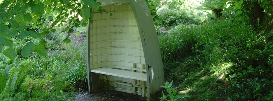 seat made from an up-turned boat in one of the local gardens