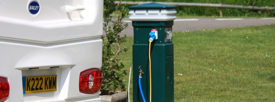 caravan connected to a service bollard on a Premium pitch