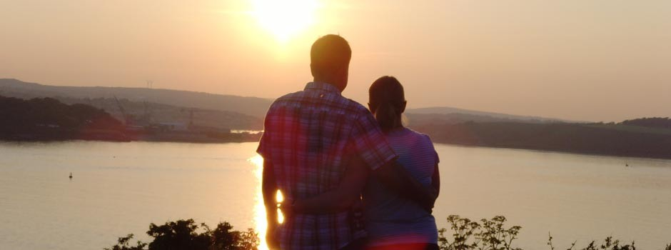 couple enjoying the sunset over the Carrick Roads