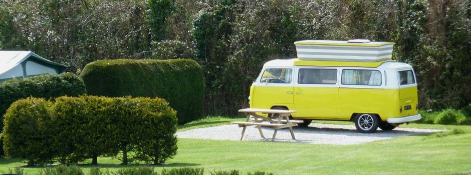 yellow vw campervan on all-weather pitch 20