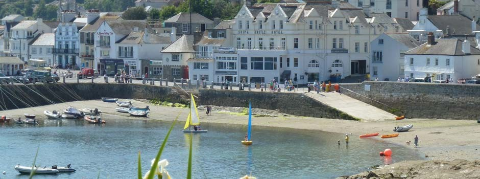the harbour in St Mawes with sailing boats and kayaks