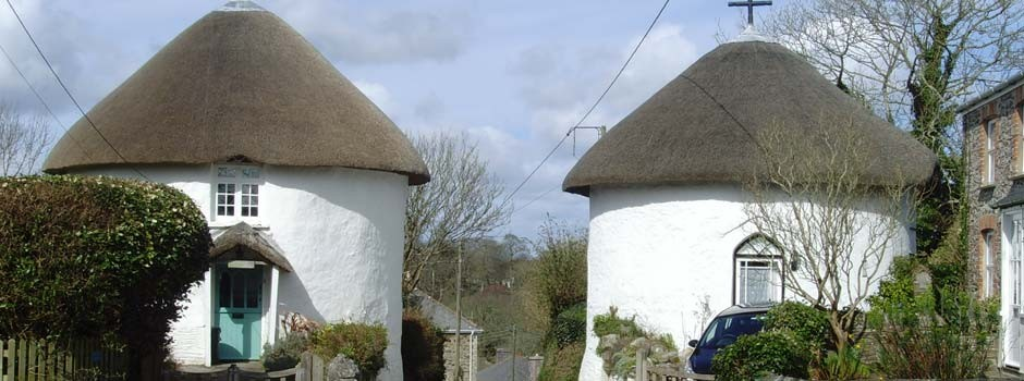 the two round houses that mark the entrance to Veryan