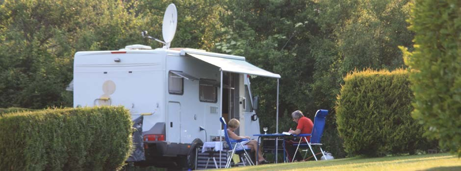 people sat outside a motorhome on pitch 14