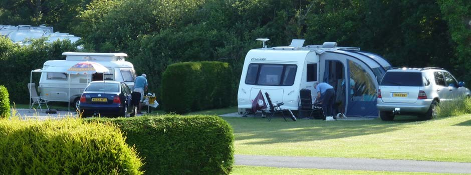 people busy outside their caravans on pitches 22 and 23